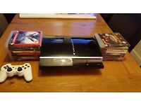 Playstation 3: 60 gbconsole with 16 games and white offiicial controller
