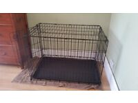Large dog crate. 90 cm x 58 cm x 63 cm. Suits large breed dog or puppy. Great for house training.