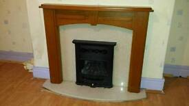 Marble and wood fireplace surround with cast iron gas fire included