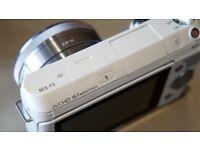 Sony Alpha NEX-F3 16.1MP Digital Camera - White (Body Only) + 3 Filter lenses