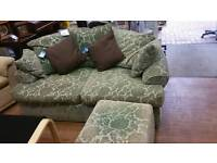 Sage green 2 seat sofa and fòt stool.Feather filled cushion