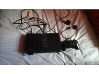 Playstation 2 with 17 games and extras