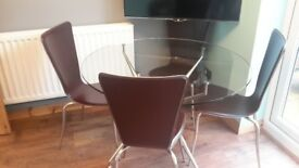 Dining room table and leather chairs
