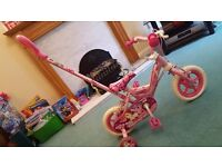 Girls bike. Avigo 10 inch unicorn bike with steering handle