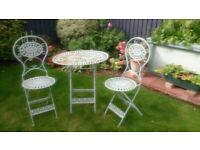 Lovely Wrought Iron Table and 2 Chairs that fold up for storage