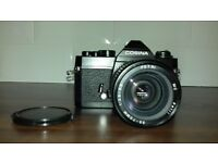 COSINA CT-1A 35mm camera & 35-70mm PETRI lens 1:3.5-4.5. With lens, cap and case.