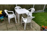 Plastic garden table and chairs