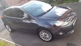 5.8 liters per 100km and £20 a year road tax. Nice clean car.