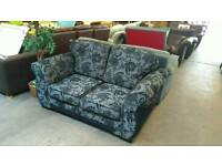 Black and grey floral patterned sofa