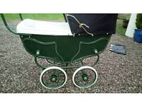 Old fashioned silver cross pram ideal for restoration