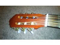Guitar excellent condition and suitcase