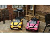 2 X electric mini cars in pink and yellow