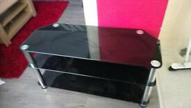 Black glass TV stand, max to size 50""