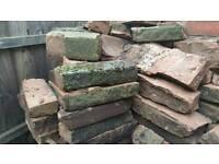 Weathered cotswold brick wall