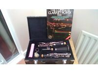 Clarinet for sale, together with box and book