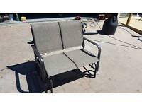 Rocking two seater garden chair