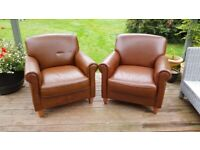 2 faux leather armchairs