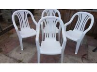 4 Matching White Plastic Stacking Chairs in Good Clean Condition