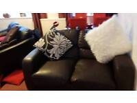 Brown Dfs solid 2 seater sofa.