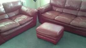 Three and two red leather sofas and footstool nice condition