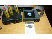 Camping burner portable hob excellent condition with spare 4 cartridges and case ideal for boat