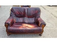 Leather Burgundy 2 seater Sofa with 2 arm chairs and a foot stool