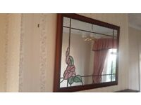 over mantel mirror with flower detail.