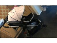Pink mother care pram with matching car seat, never used nappy bag , and footmuff