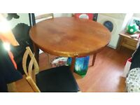 6 seater round extendable table with 3 chairs