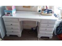 Solid wood desk painted white. On castors.
