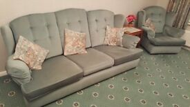 3 seater sofa plus 2 armchairs. Light green.