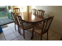 Solid wooden extending dining table and 6 chairs