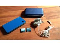 Nintendo DSi XL with case, charger & 2 games