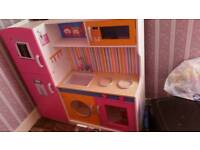 Large wooden toy kitchen