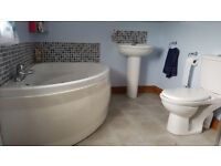 White bathroom suite to include Jacuzzi bath