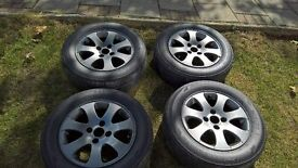 peugeot 15 inch ghost alloy wheels they look black or silver depending on light high shine