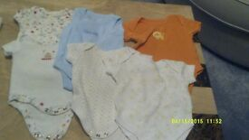 selection of baby clothes 1st size