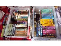 over 50 VHS video tapes. Many complete box sets unused.