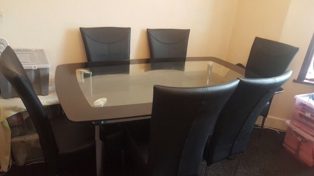 Dining Table Solid Double Glass With 6 Black Chairs In Manor