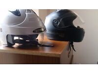 two motorcycles helmets, one silver £10 second is £15