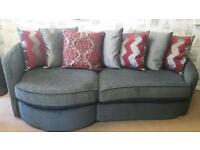 Silver grey fabric cuddle sofa. Delivery available