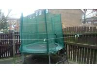 8 foot kids trampoline with safety net and entrance ladder.