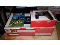 Nintendo switch with zelda and pro controller new condition with box and carry case £415