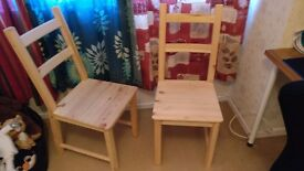 Two real wood dining chairs - unvarnished and unstained.