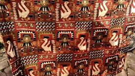 Aztec type print on a pair of handfinished lined curtains. As new.