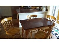 Granite topped solid pine kitchen table and four chairs