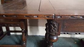 Antique Tudor style table and 6 chairs