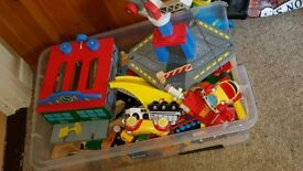 Children's toy train set and extras.