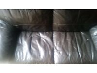 2 seater dark brown leather sofa good condition can deliver local