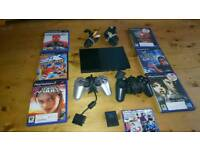 Sony PS2 console, 8mb memory card, 2 controllers and 6 games